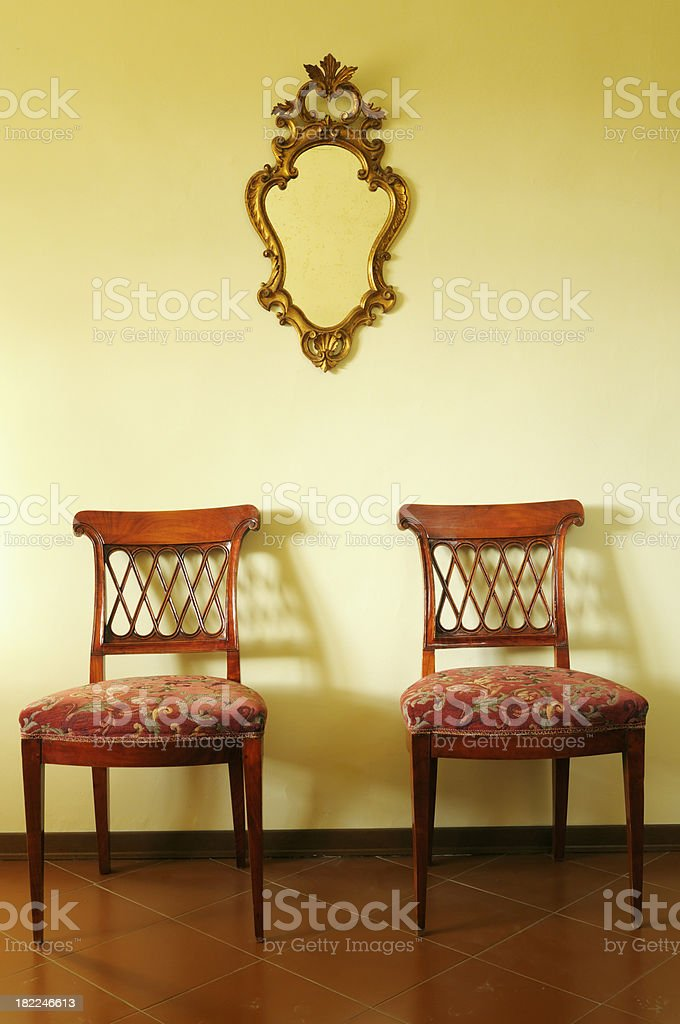 Vintage Gold Mirror and Old Chairs royalty-free stock photo