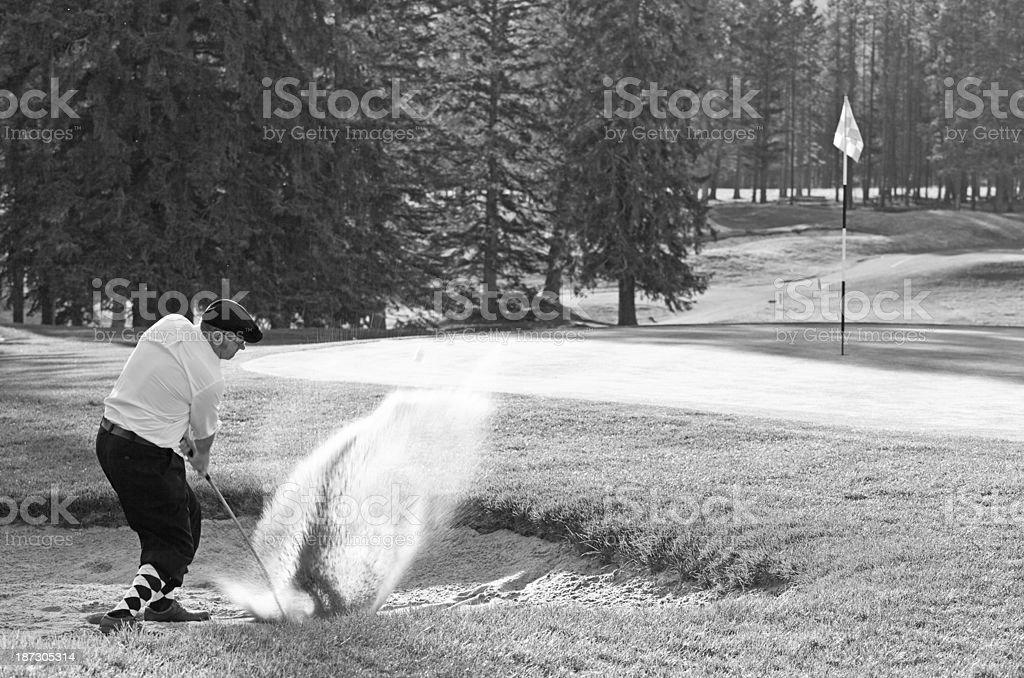 Vintage Golfer Playing Bunker Shot stock photo