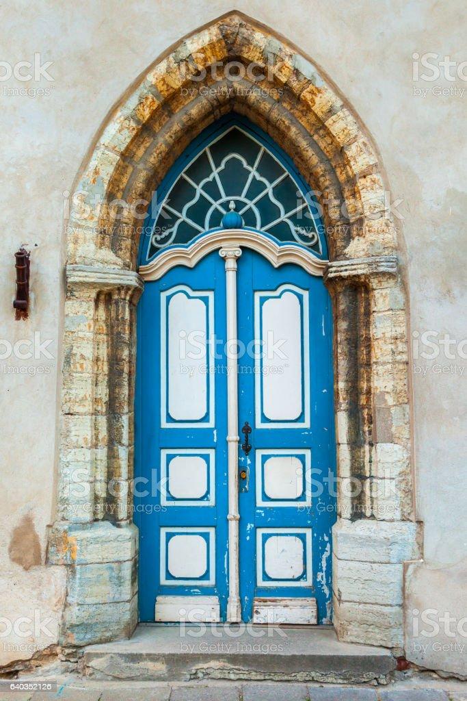 Vintage Gothic door on a medieval building facade stock photo
