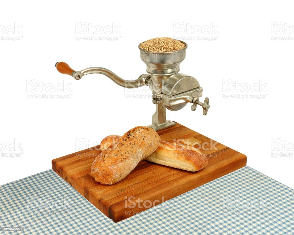 Vintage Grain Mill with Bread stock photo