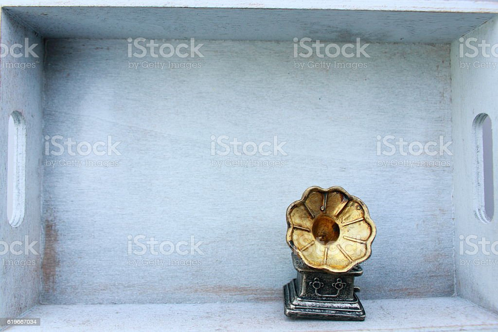 Vintage gramophone ornament in white wooden box stock photo