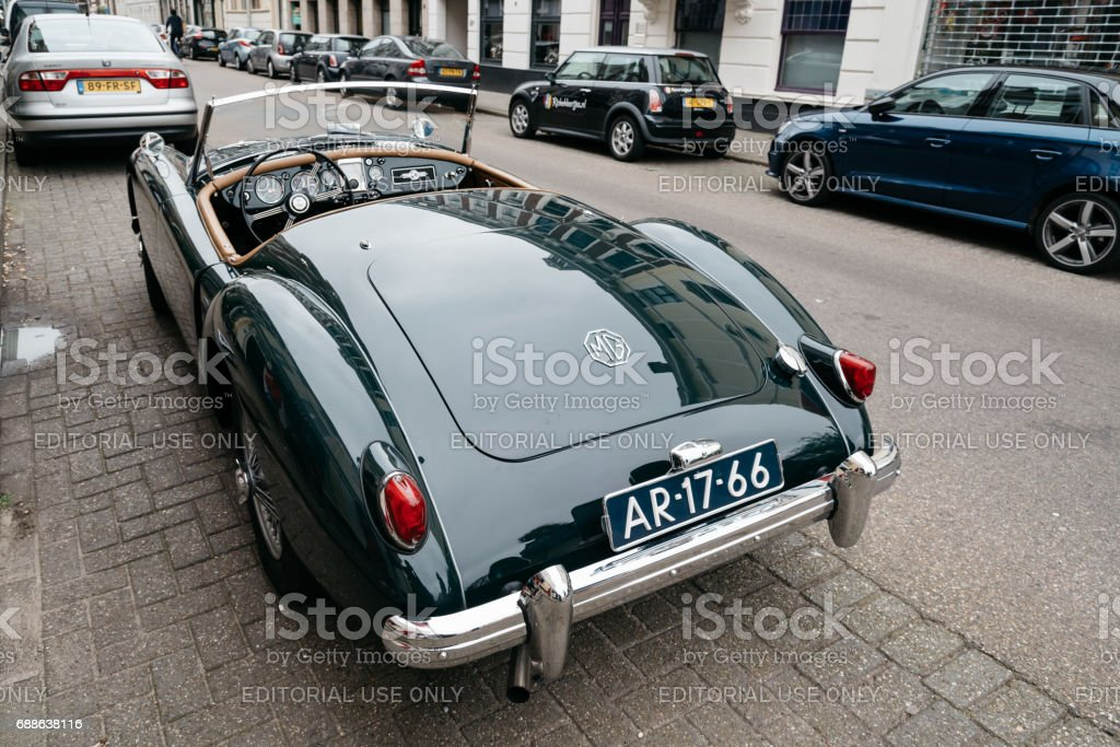MG vintage green car parked on the street. Rear view. MG Car is a British sports car. stock photo