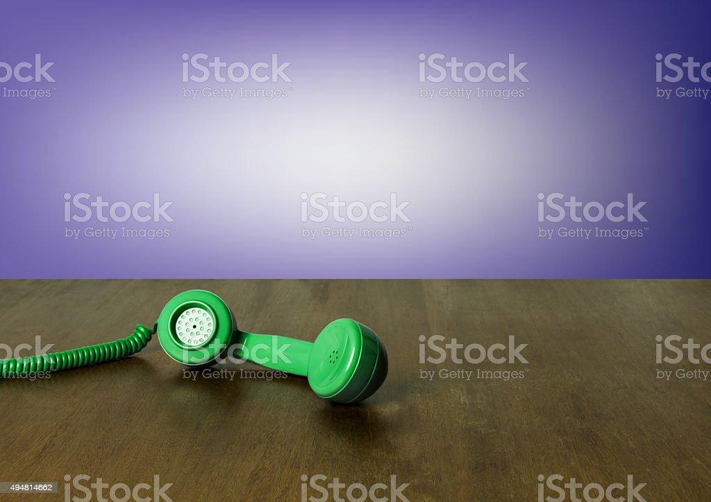 Vintage Green Headphone, Wooden Background stock photo