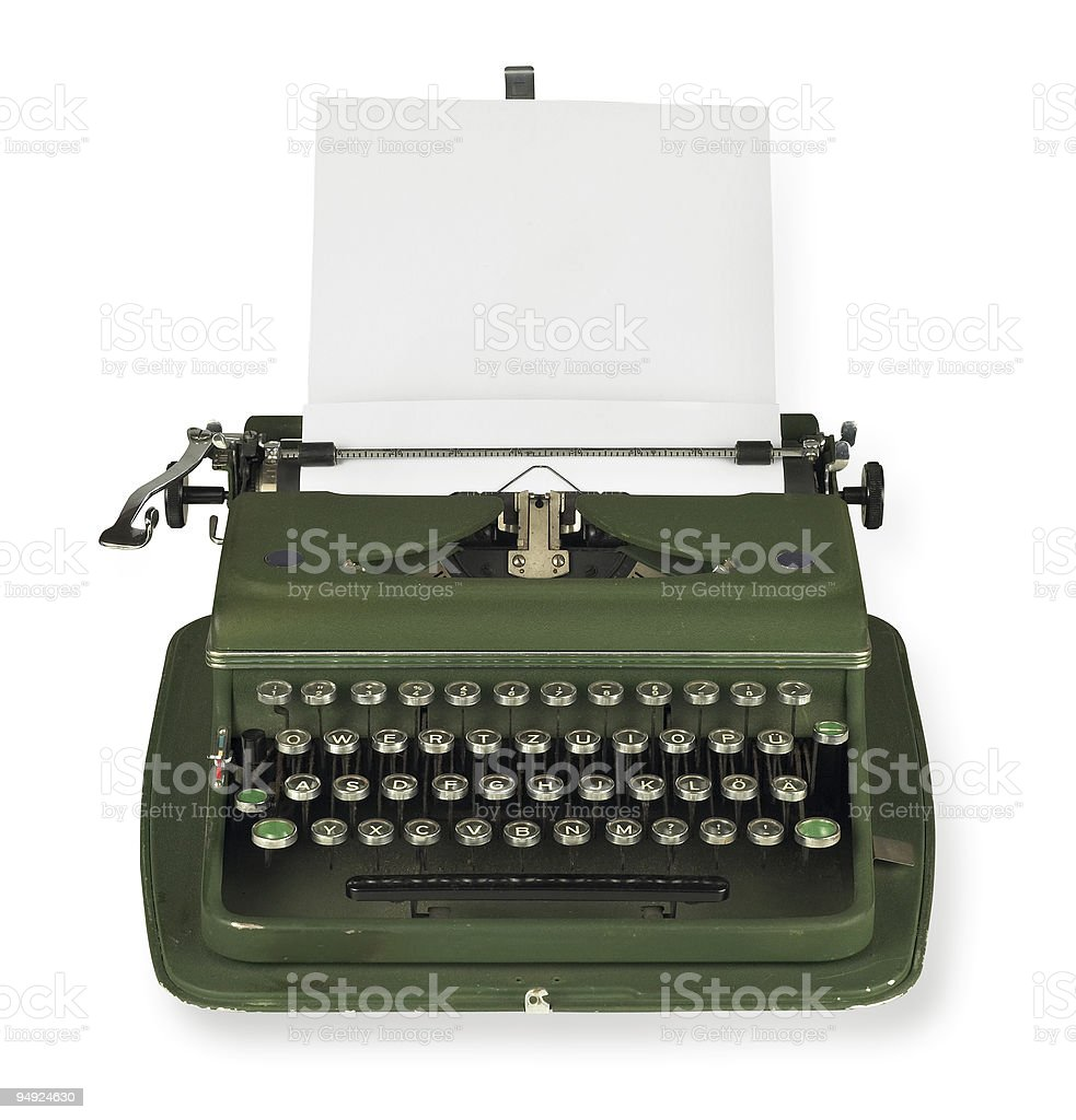 Vintage, green typewriter with paper on white background stock photo