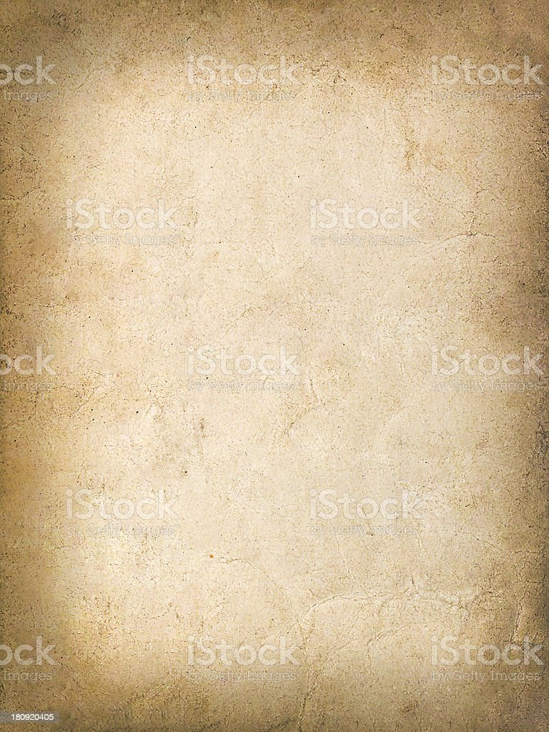 Vintage grungy background of old yellow paper royalty-free stock photo