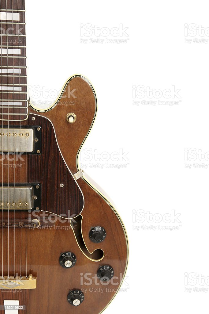 Vintage guitar isolated on white royalty-free stock photo