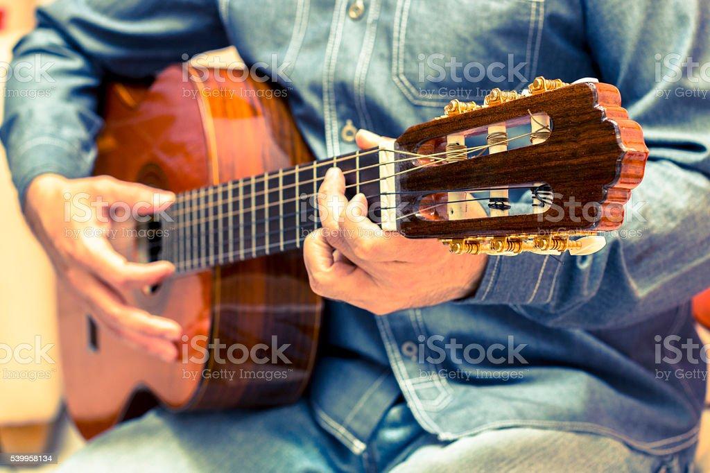 Vintage guitar player stock photo