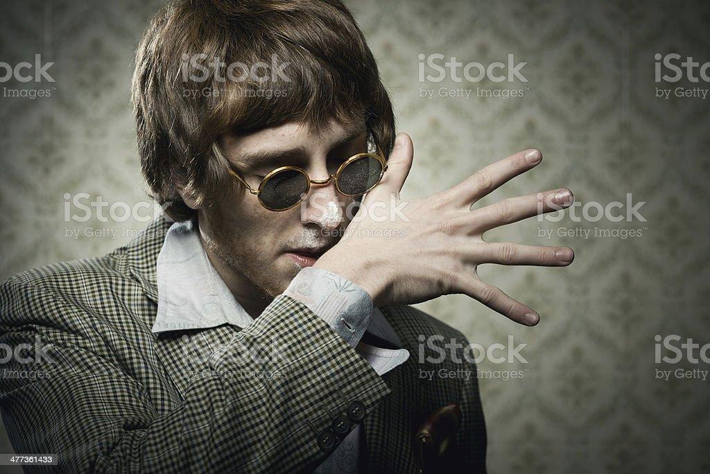 Vintage guy enjoying drugs royalty-free stock photo