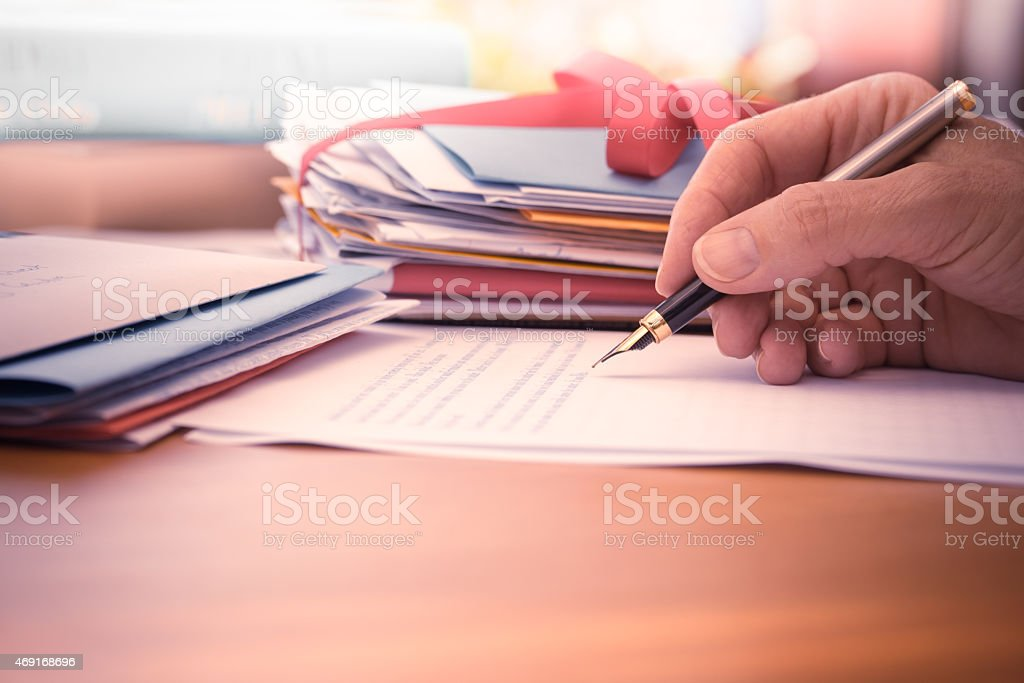 Vintage Hand with Pen Writing a Letter stock photo