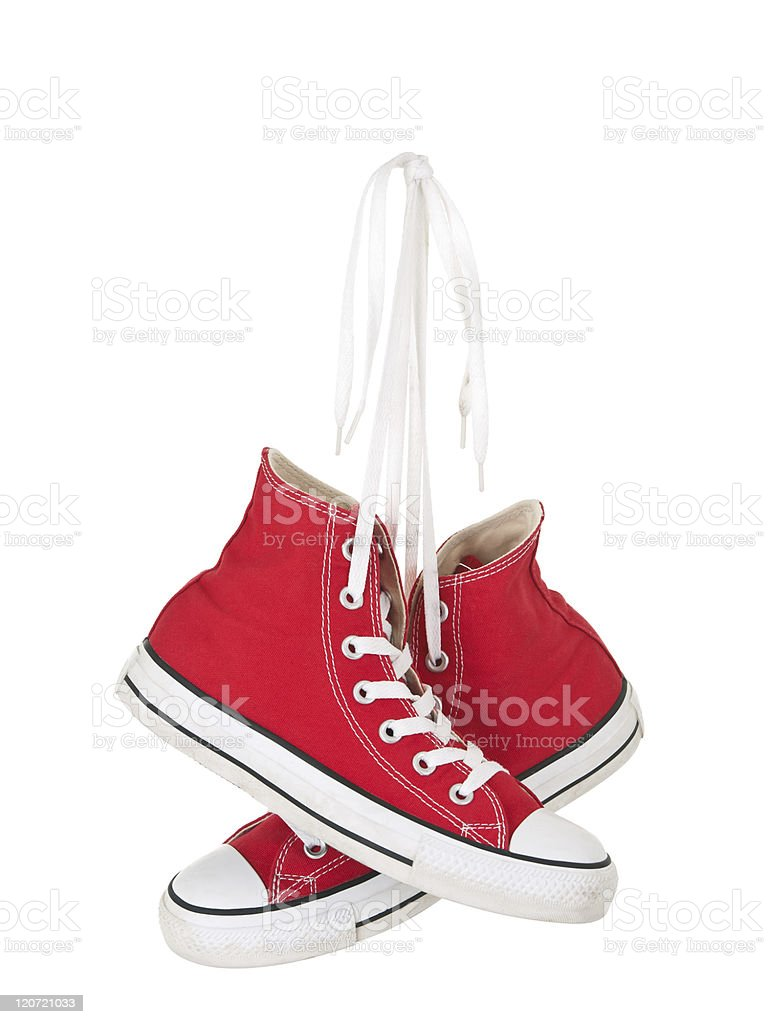 Vintage hanging red shoes tied stock photo