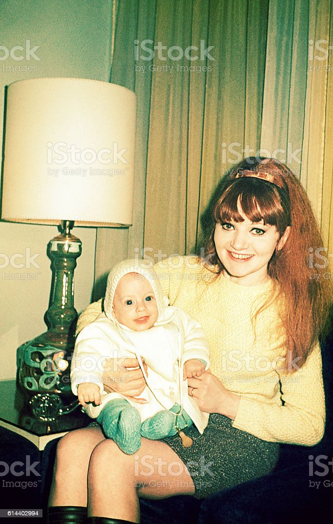 Vintage happy mom holding her son stock photo