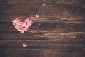 Vintage heart from flowers on wooden table. Valentine day background.