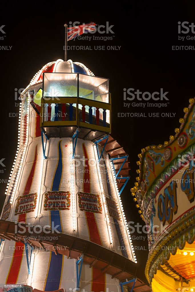 Vintage Helter Skelter lit up at night on Brighton Pier stock photo