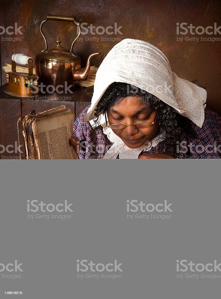 Vintage herb woman reading recipe royalty-free stock photo