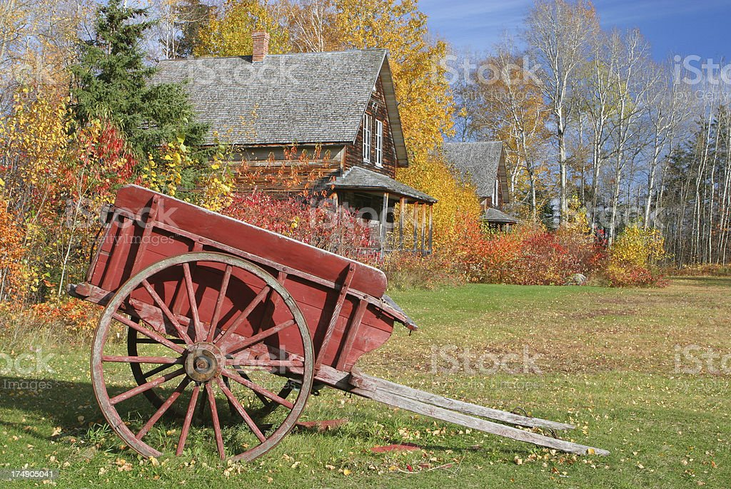 Vintage horse cart and house stock photo