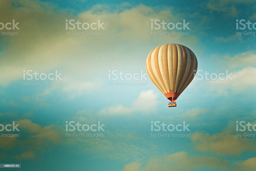 vintage hot air balloon in the sky stock photo