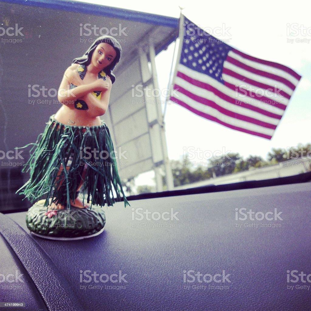 Vintage Hula Girl and American Flag stock photo