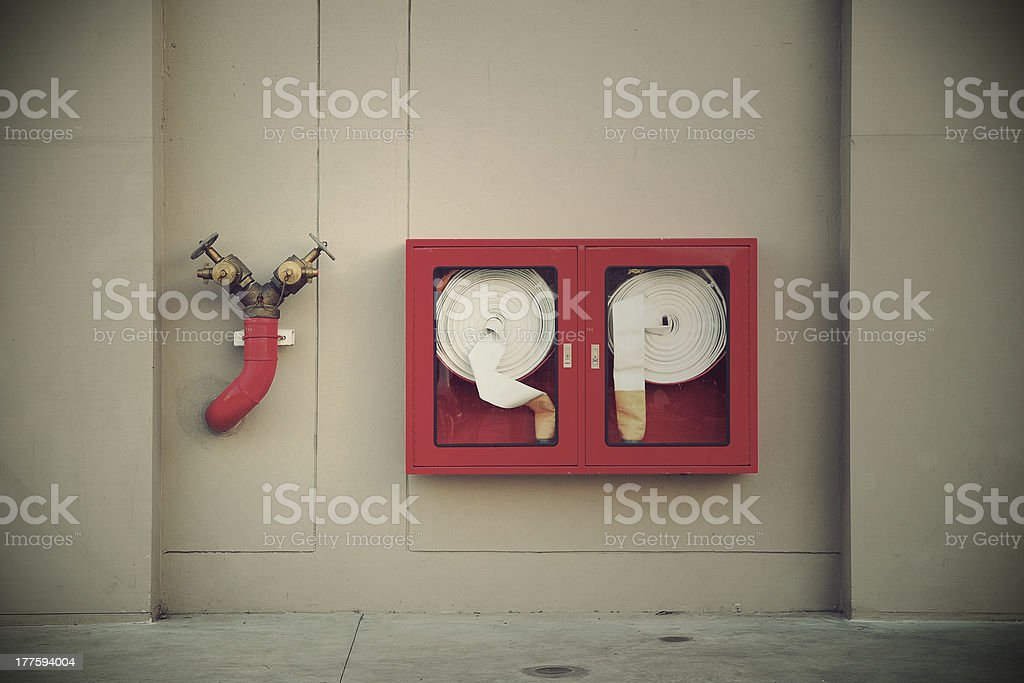Vintage Hydrant with water hoses and fire extinguish equipment royalty-free stock photo