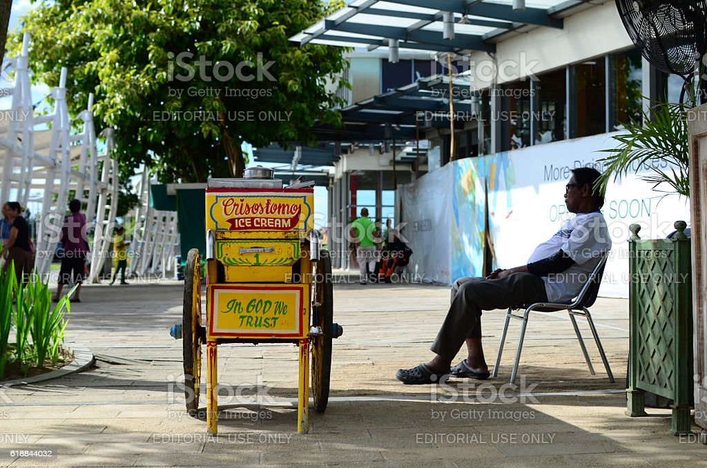 Vintage Ice Cream wooden Mobile Cart on city sidewalk stock photo