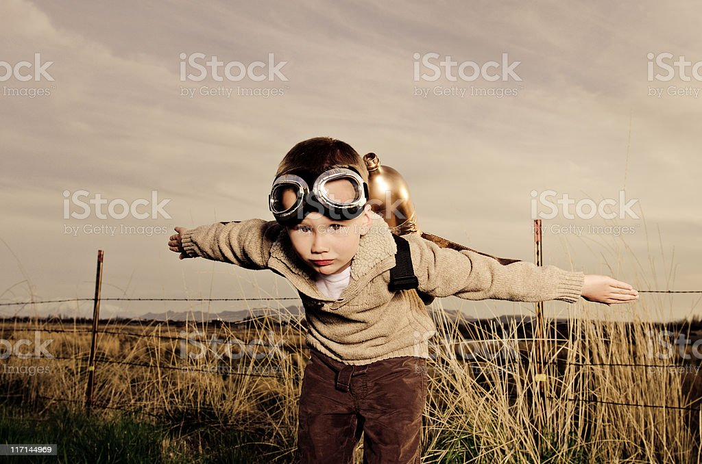 Vintage image of a child wearing jet pack flying stock photo