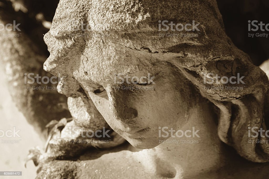 Vintage image of a sad angel on a cemetery stock photo