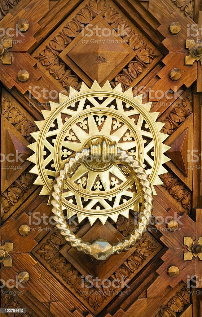 Vintage image of ancient door's knocker on a wooden door royalty-free stock photo