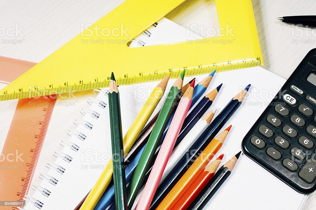 Vintage image of crayons and ruler on table from above stock photo