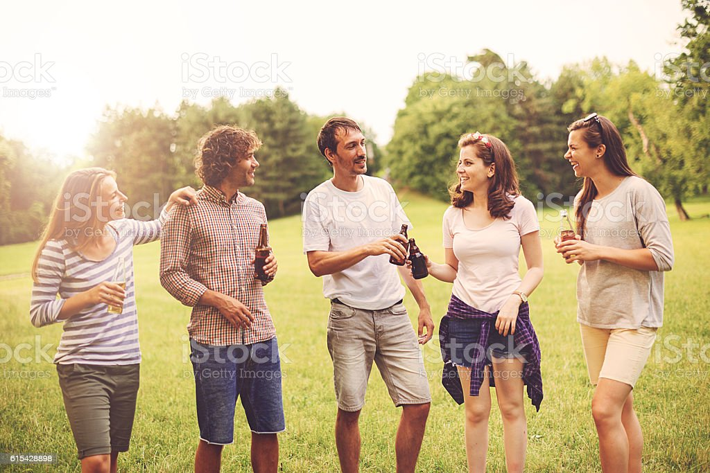 Vintage image of group of friends in nature stock photo