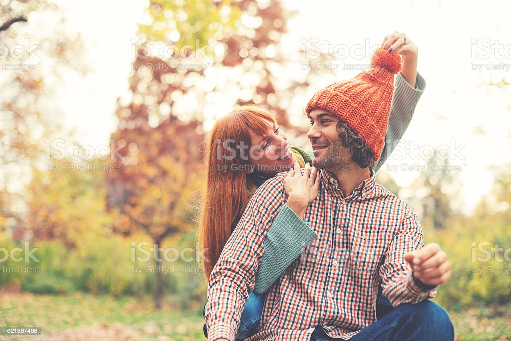 Vintage image of loving couple in park in autumn stock photo