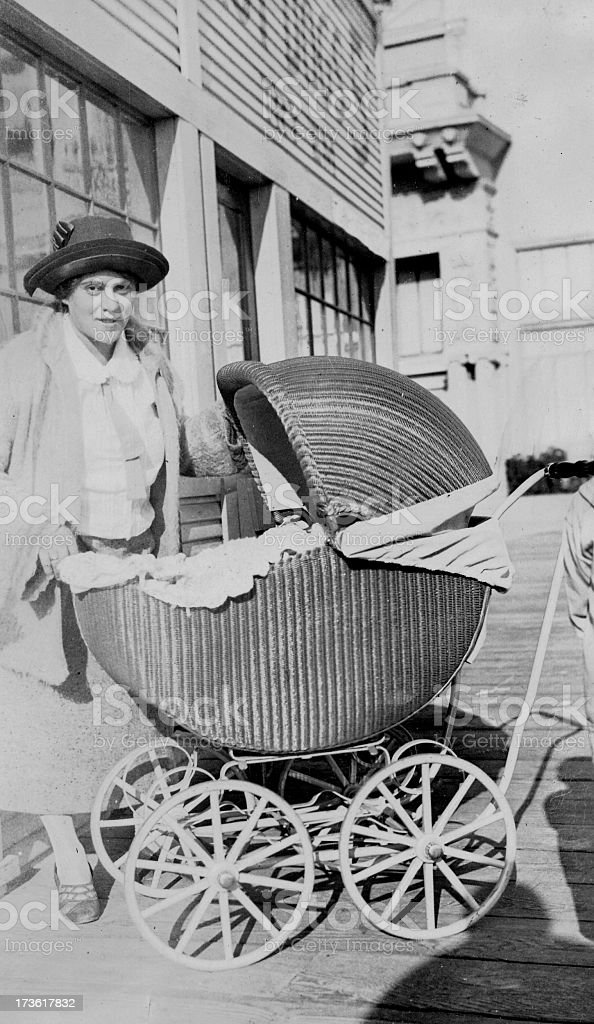 Vintage Image of Mother With Baby Buggy royalty-free stock photo