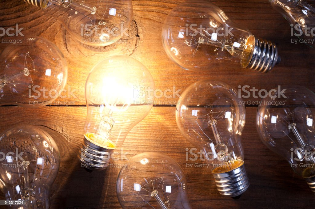 Vintage incandescent bulbs on old wooden table stock photo