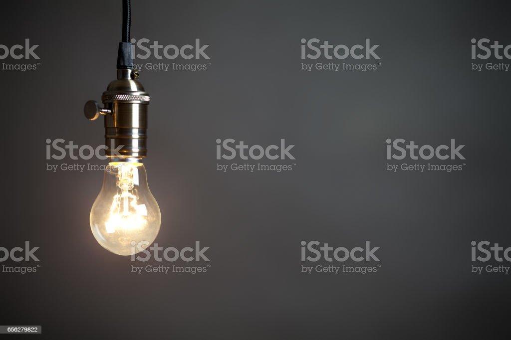 Vintage incandescent light bulb on grey background stock photo