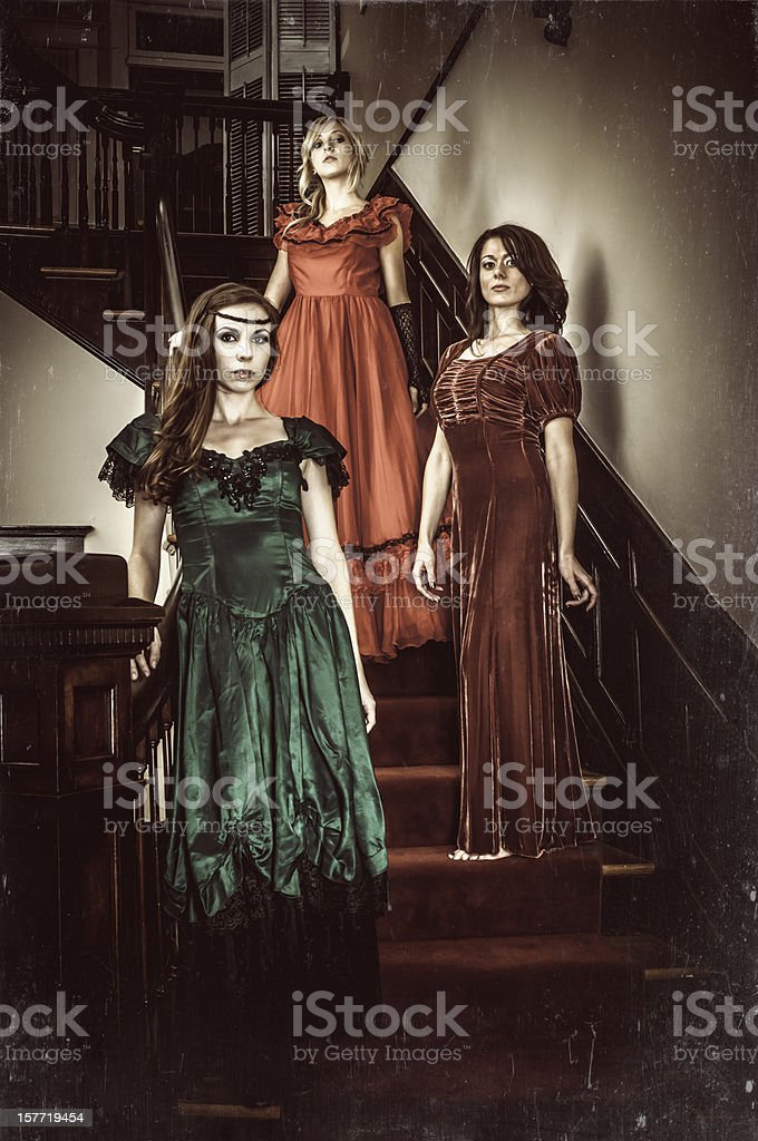 Vintage indoor portrait of young women on the stairs (II) stock photo