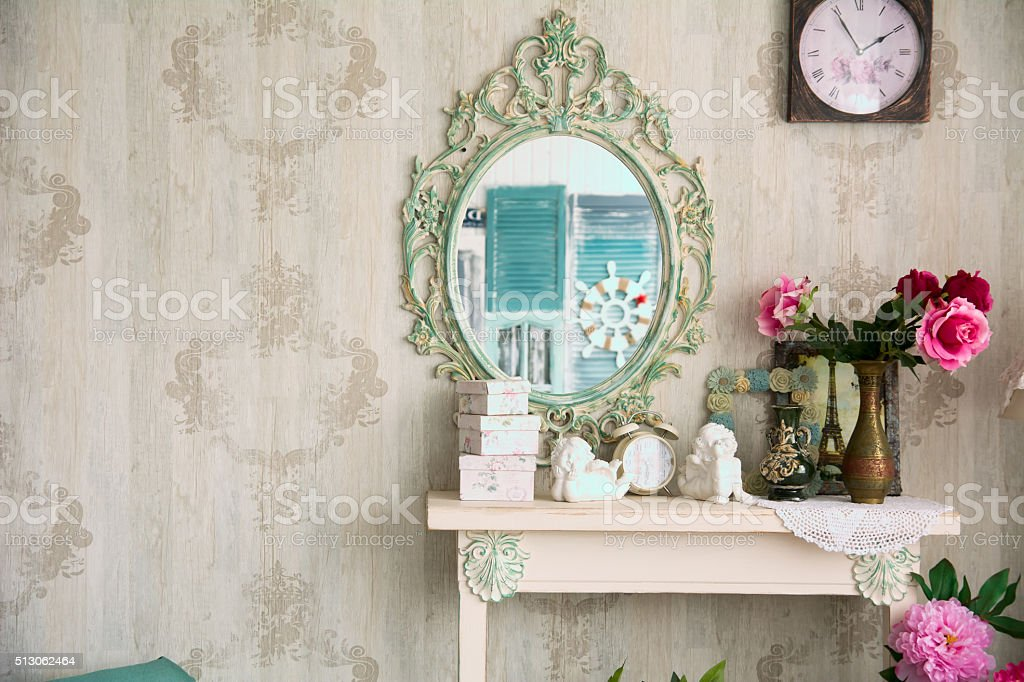 Vintage interior with mirror and a table, vase stock photo