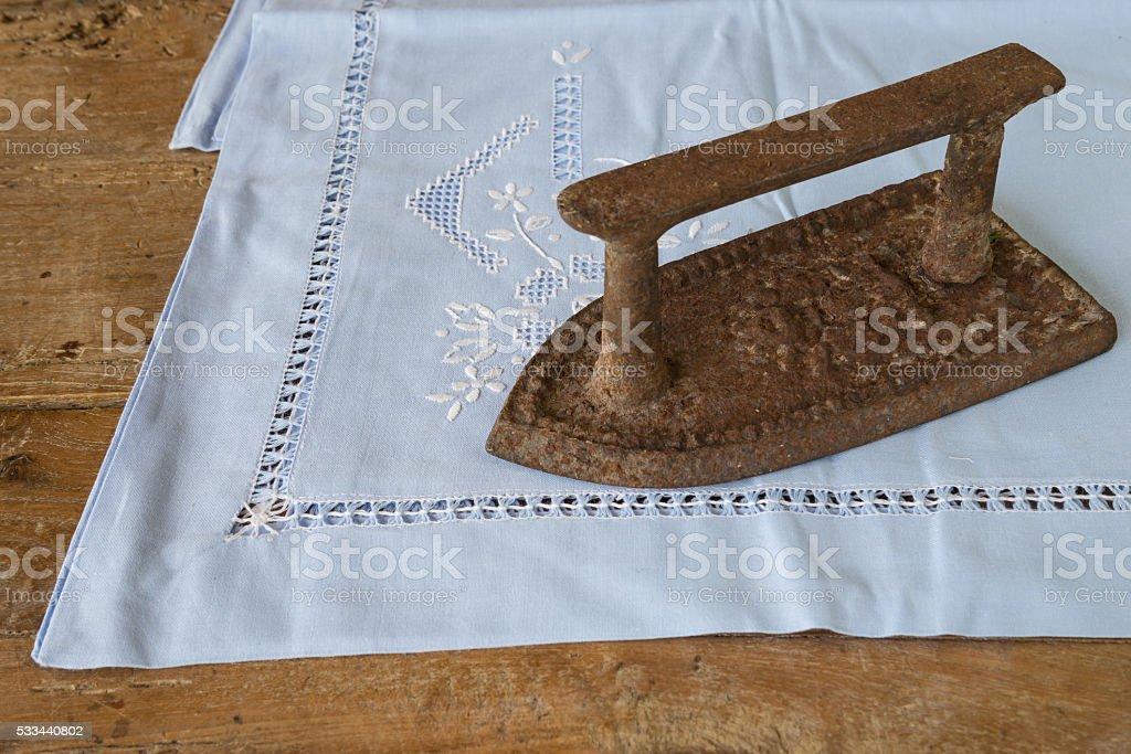 Vintage iron on a serviette stock photo