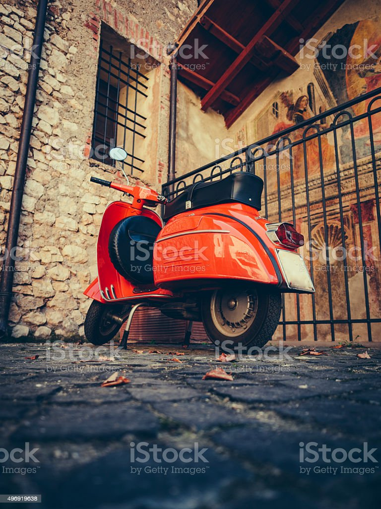Vintage italian scooter on cobbled street stock photo