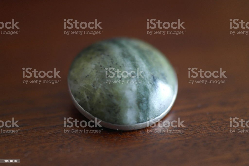 Vintage Jade stone and solid silver brooch stock photo