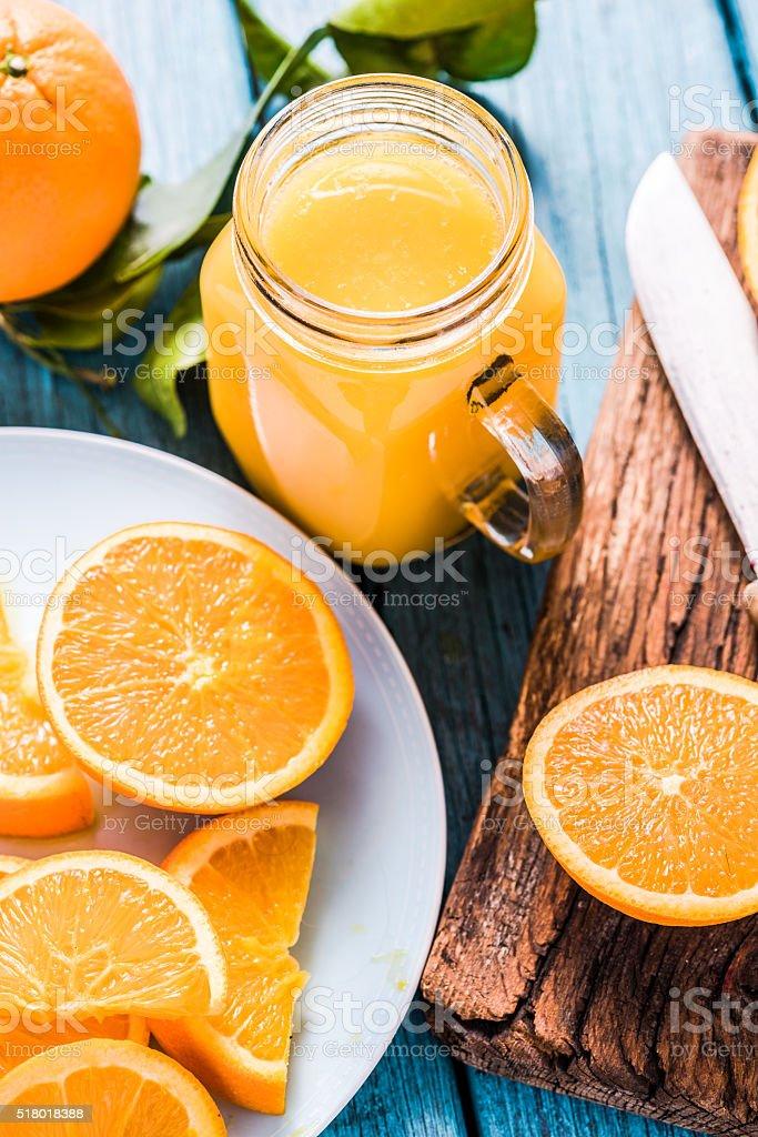 Vintage jar with fresh orange juice stock photo