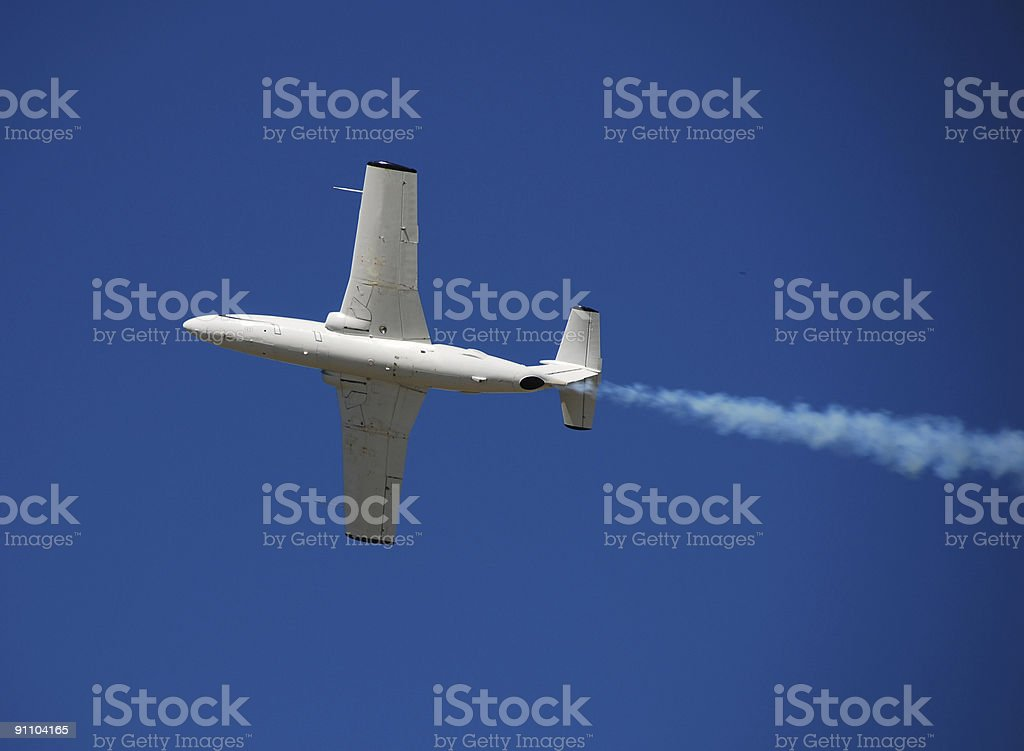Vintage jet airplane soaring high in the sky royalty-free stock photo