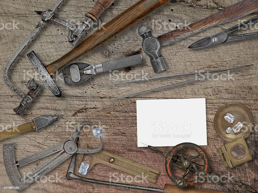 vintage jeweler tools over wooden bench stock photo