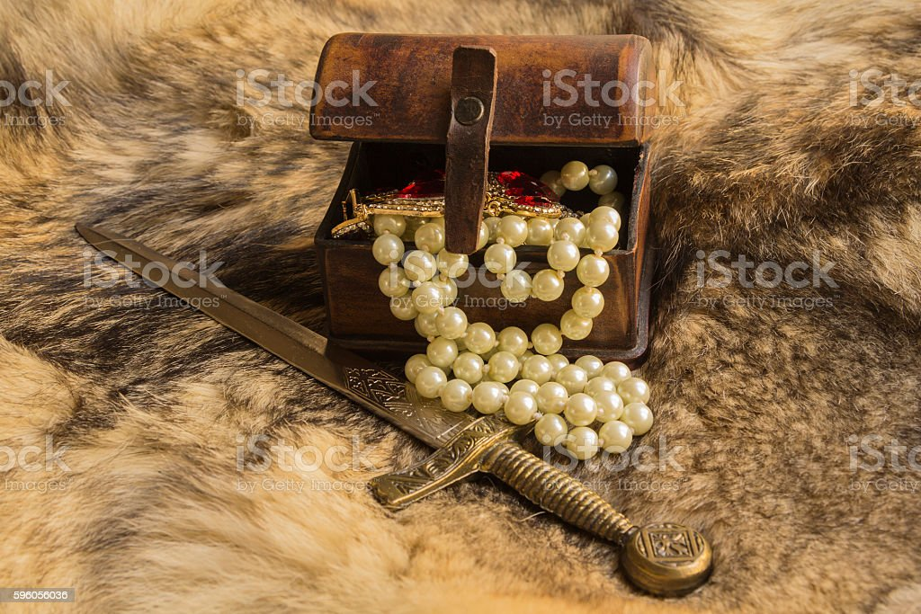 vintage jewelry box with jewelry and dagger stock photo