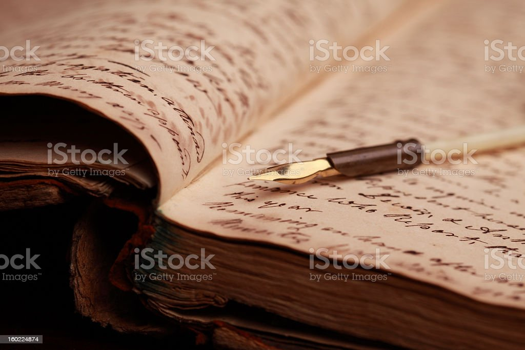 Vintage Journal and Quill Pen stock photo