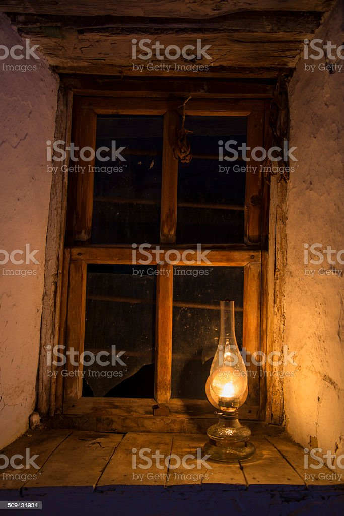 Vintage kerosene lamp at window stock photo