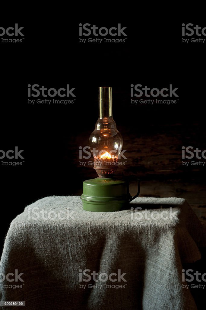 Vintage kerosene lamp  on the linen tablecloth. stock photo
