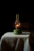 Vintage kerosene lamp  on the linen tablecloth.