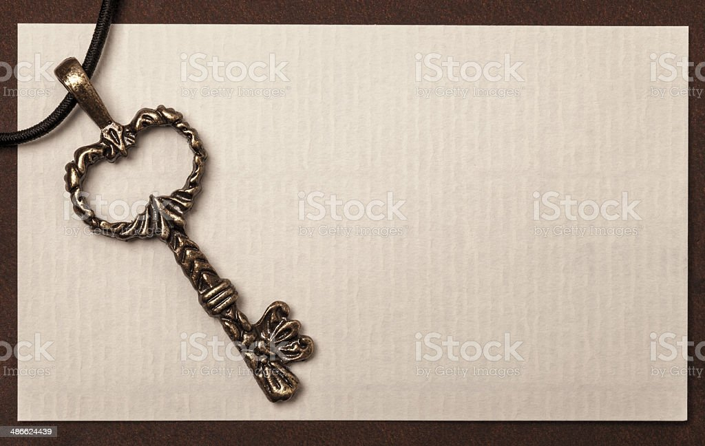 Vintage key and paper texture background royalty-free stock photo