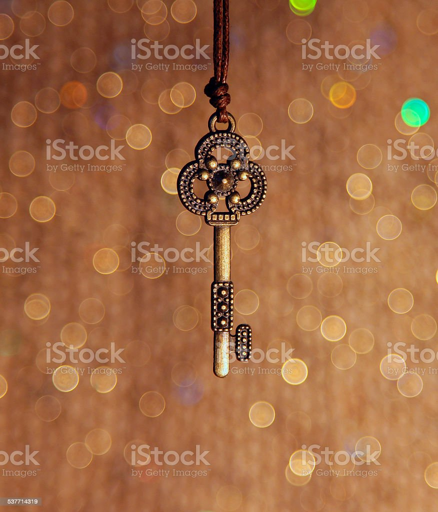 Vintage key on a shiny background stock photo