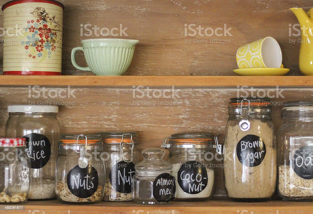 Vintage Kitchen Hutch with baking ingredients stock photo