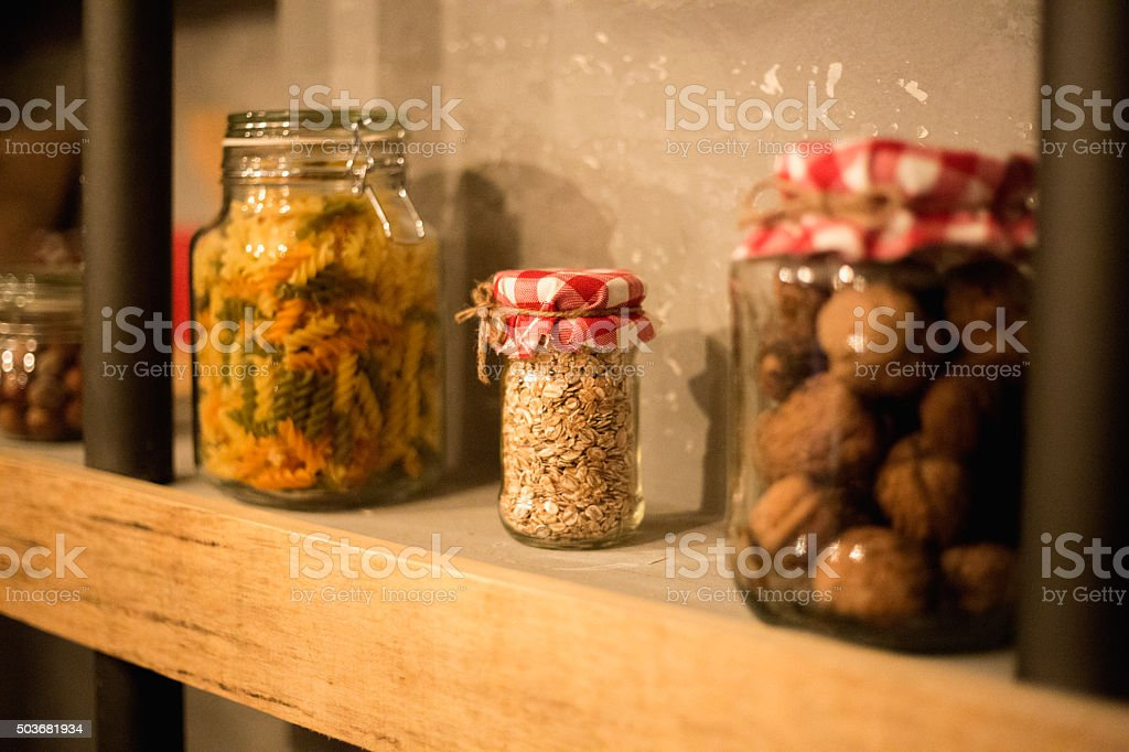 Vintage Kitchen Hutch with ingredients in jars stock photo