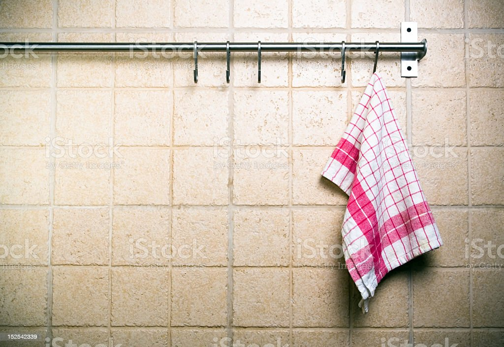 Vintage kitchen, towel on wall alone stock photo